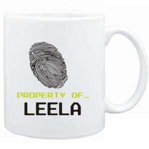 Mug White  Property of _ Leela   Fingerprint  Female