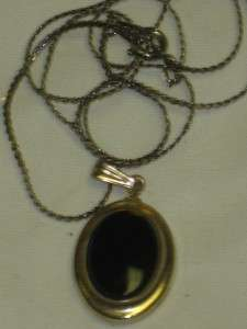 Older Looking Black Oval Stone Inside Gold Tone With Necklace